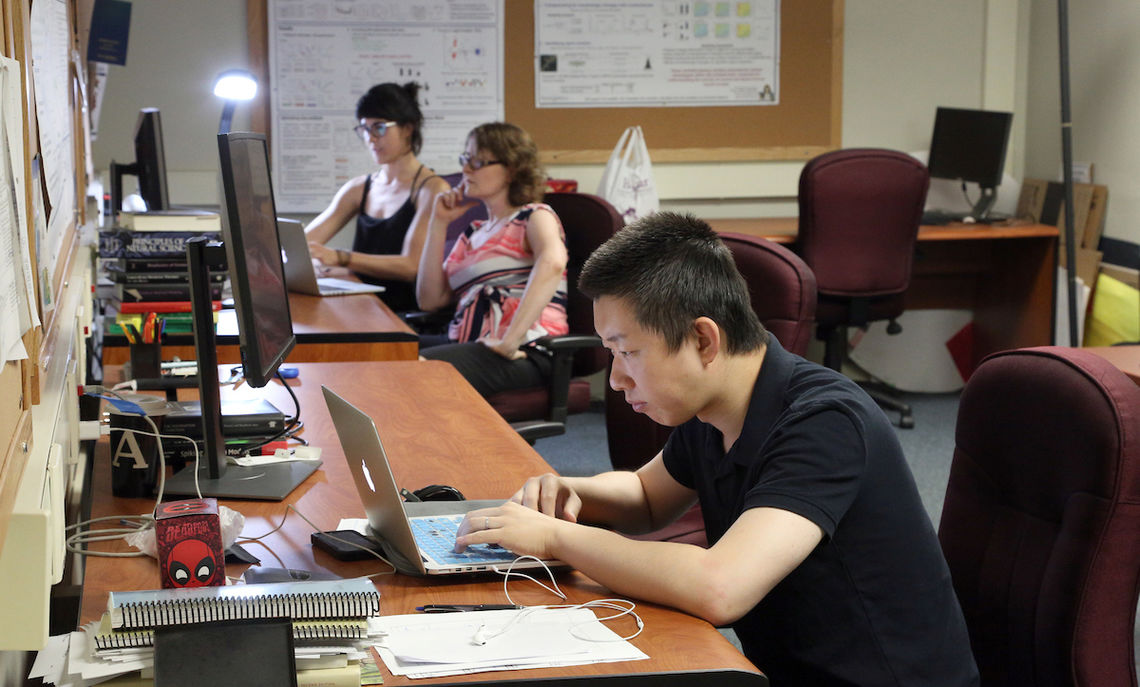 At work with Weaver (center) in Stager Hall, postdoctoral assistants Hanbing Song and Sara Ibañez.