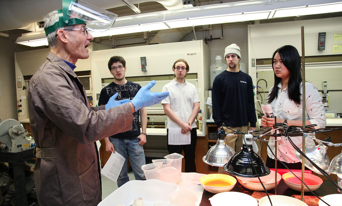 Professor Mertzman in his F&M lab instructing his students on rock analysis.
