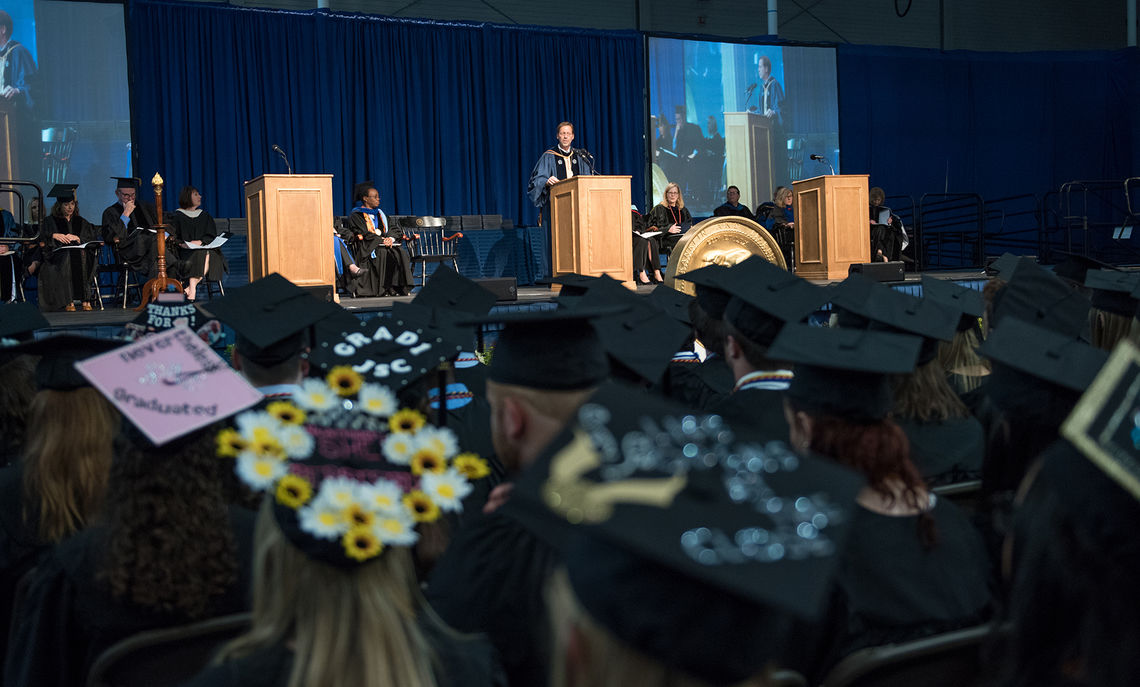 Franklin & Marshall College President Daniel R. Porterfield and the platform party look out upon a sea of new graduates during the May 13 Commencement ceremony at F&M.