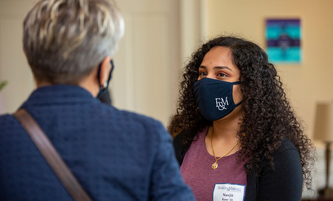 "Senior Navjit Kaur, a Roschel College House Advisor, chats with F&M President Barbara Altmann during the ceremony recognizing Dr. Robert and Anna Roschel's $6.5 million dollar gift to rename the house.  The College House system ""makes everyone more connected to the academic setting,"" Kaur said. ""Community is the thing that keeps me going. Just being able to connect with people … is the best thing by far. And with this house specifically, it's very easy because we have upperclassmen and first years all living together. So we have the space to have these meaningful conversations."""