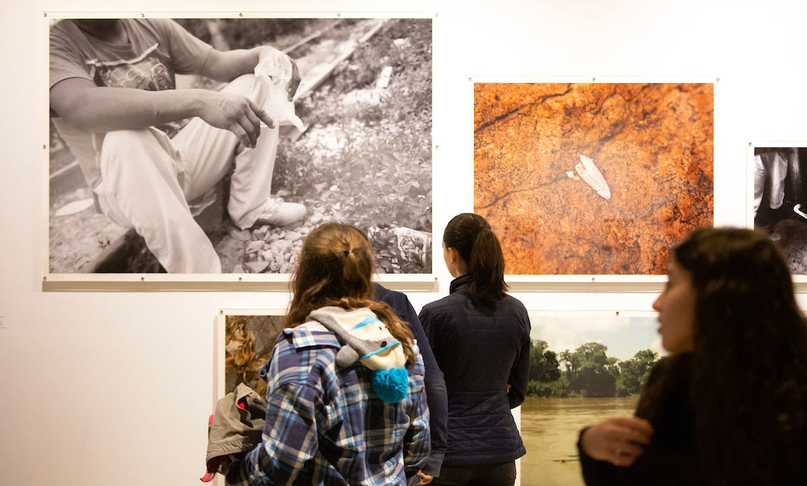 "The photography of Michael Wells, De León's research partner, depicts the migrants and the unforgiving conditions they face in this Phillips Museum's exhibit,  ""Hostile Terrain."""