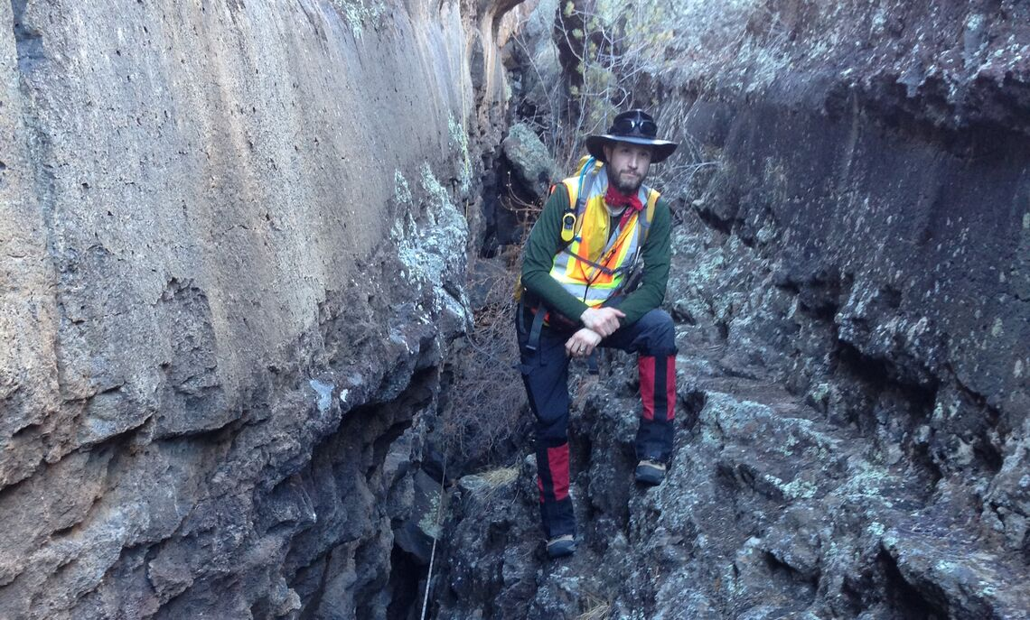 Jake Bleacher '00, NASA's  Chief Exploration Scientist of Advanced Exploration Systems, between a crevice in the lava flow.