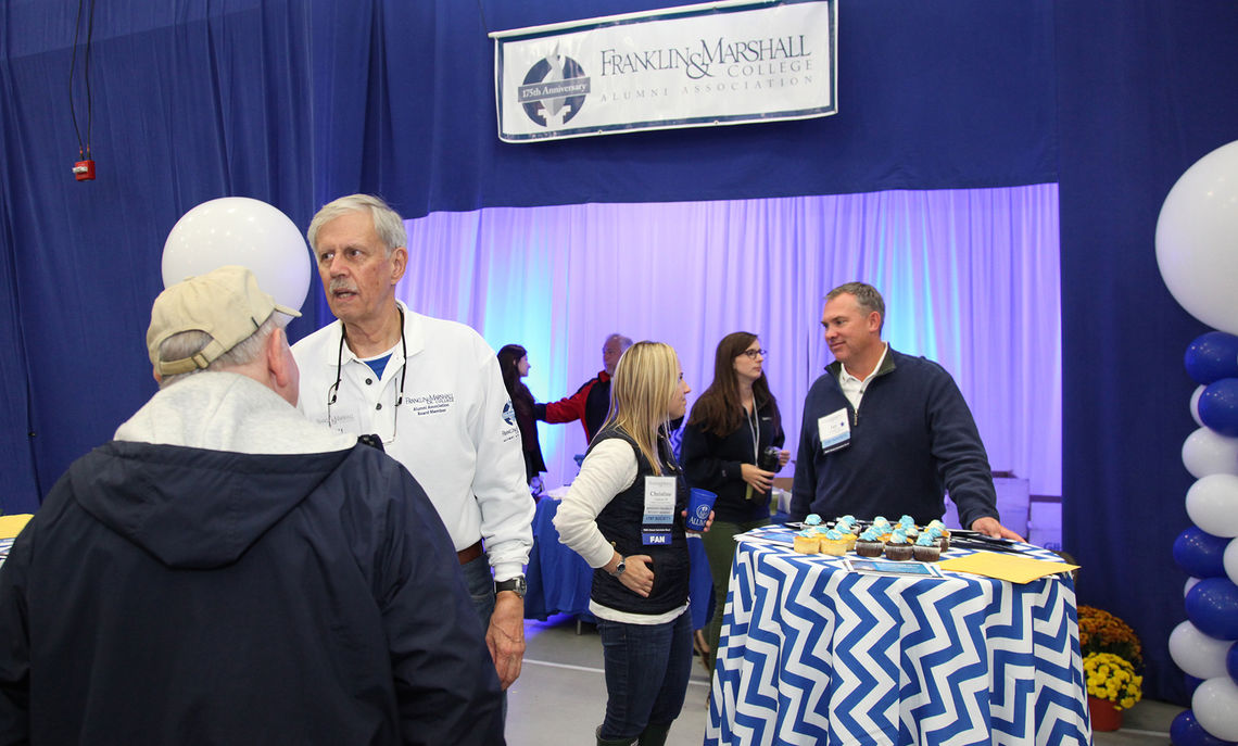 On Saturday, Bill Curtis '61 (left) was among the many alumni meeting and greeting friends at the booth set up in the Alumni Sports & Fitness Center by the Franklin & Marshall College Alumni Association, which is marking its 175th year. The association represents 26,000 alumni worldwide.