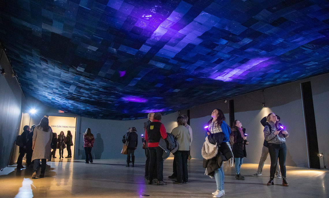 "Following the event, at a reception in the Phillips Museum, the campus community visited Clark's ""Finding Freedom"" exhibit with its night sky depicted on a ceiling-covered fabric canvass."