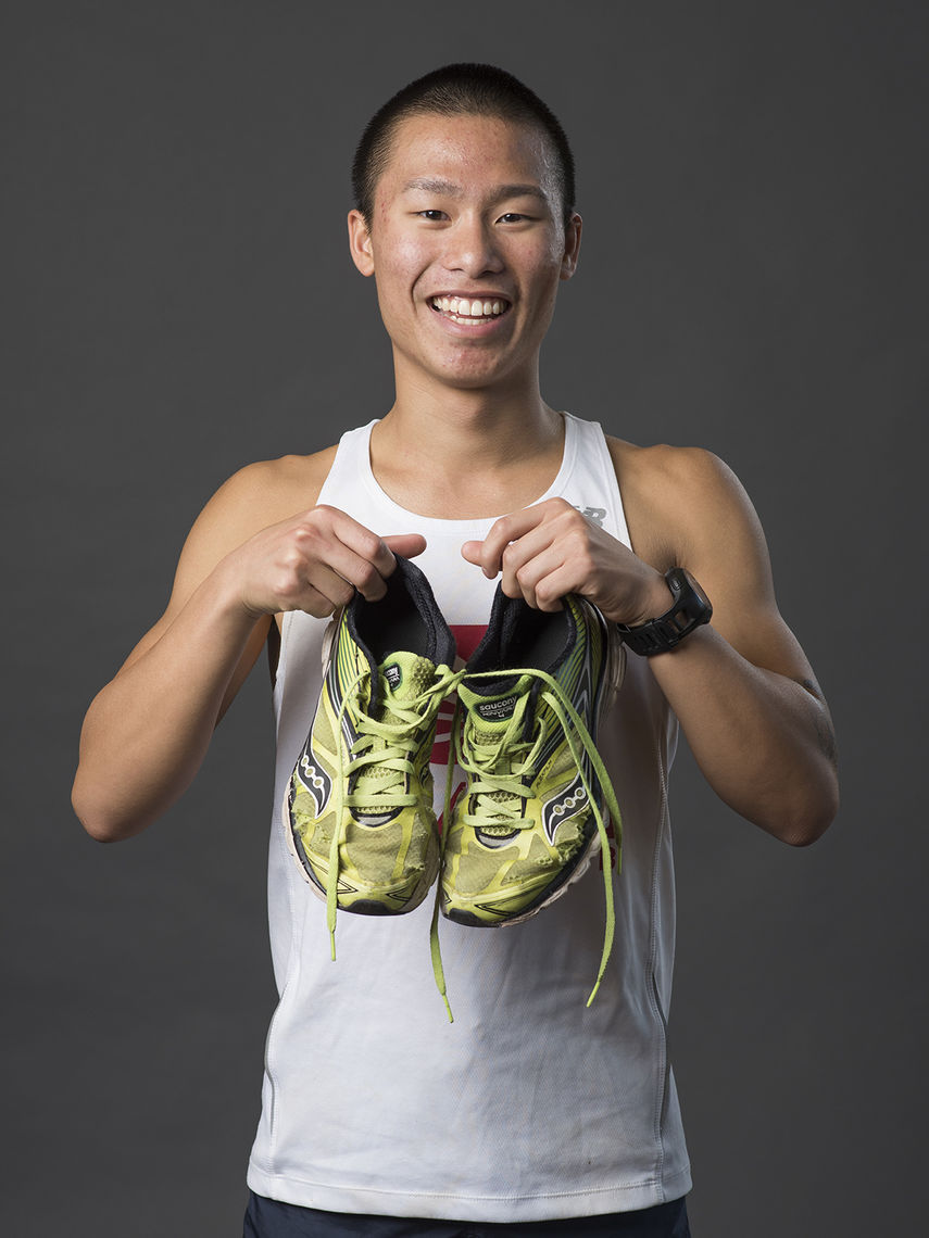 Tyler Lu, of San Jose, Calif., displays the Saucony running shoes he's had since seventh grade. They have holes in them, but for good reason; he's worn them to run 26 half marathons.