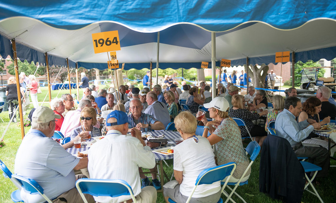 Members of the Class of 1964 join other alumni at the barbecue picnic on Hartman Green.