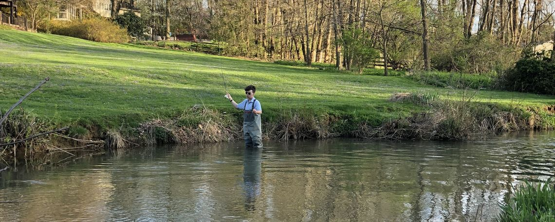 Club member Nate Bess fly fishing for trout in F&M's backyard.