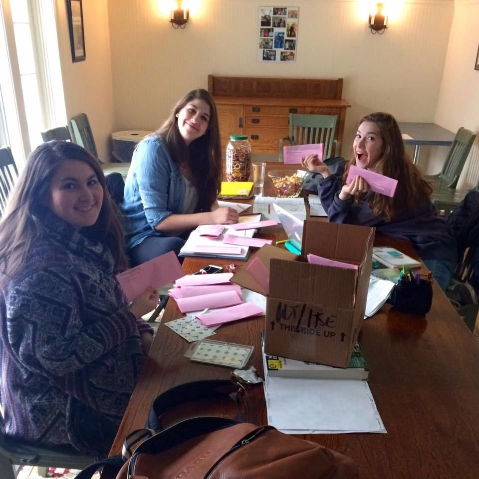 Student staffers Francesca, Arielle, and Kylie are happily folding and labeling the February events calendar. (Their happiness just might stem from the bowl of candy on table.) 2/2/16