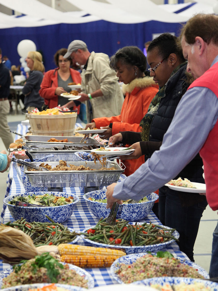 Picnic food was on the menu at Homecoming & Family Weekend's Tailgate Party in the Alumni Sports& Fitness Center — pulled pork, fried chicken, cole slaw, bean salad and more.