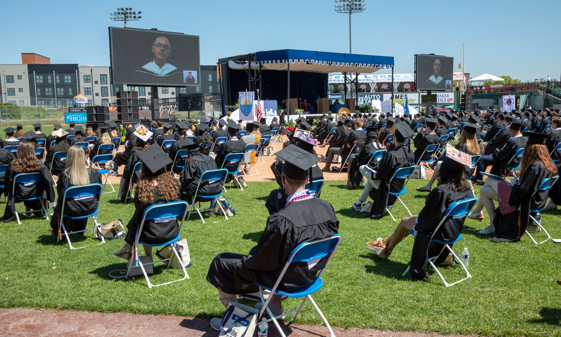 Members of the Class of 2021 watch speaker Jim Stengel '77 during F&M Commencement held May 15 at Lancaster Clipper Stadium.