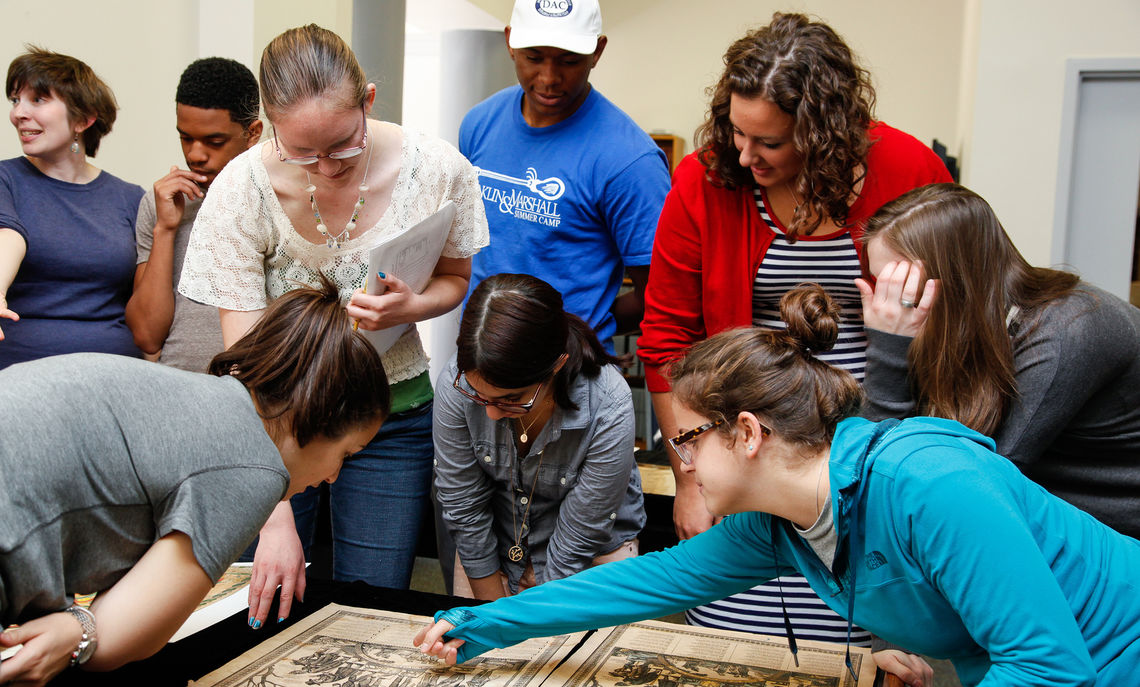 Franklin & Marshall students view various old Bibles and religious texts on display in the archives of Martin Library of the Sciences during their Cultural History of American Religion class with Professor Catherine Osborne. Here they look at Pennsylvania German broadsides, which were used as posters to put on display many years ago.