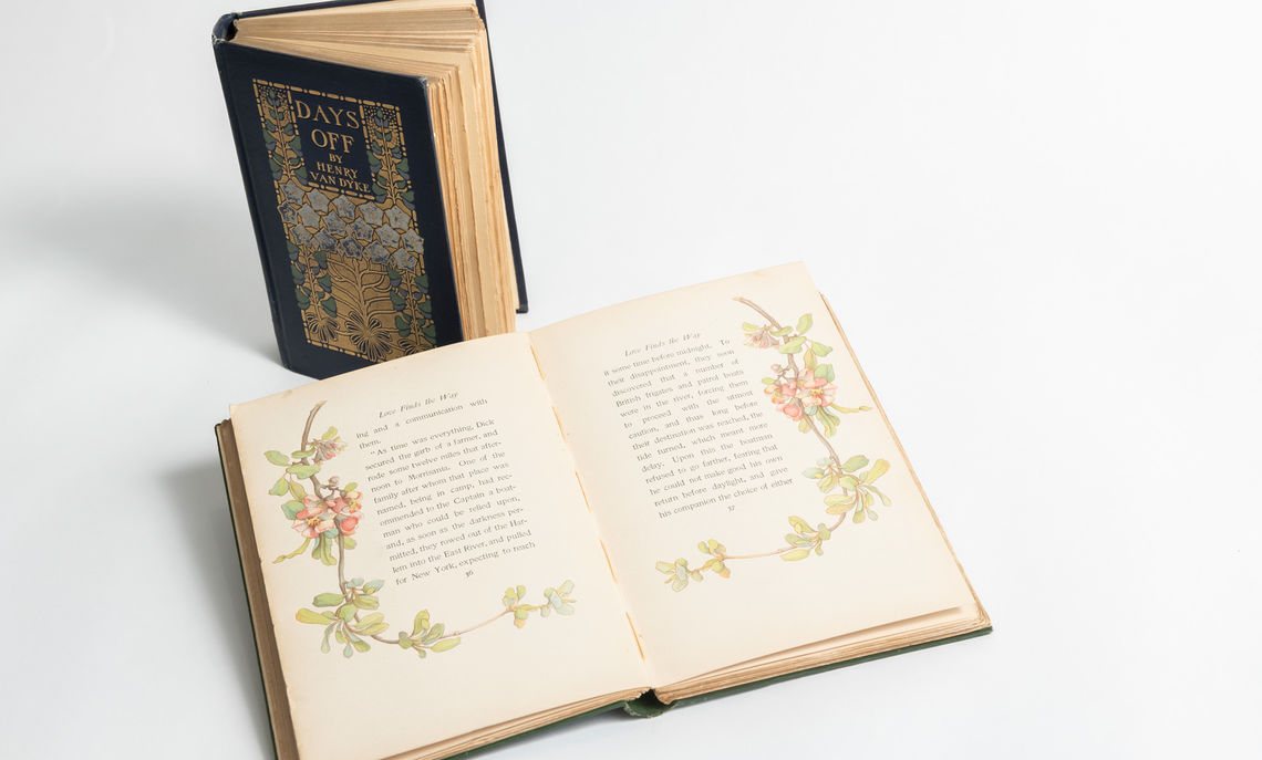 """Days Off,"" by Henry Van Dyke, and ""Love Finds the Way,"" by Paul Leicester Ford, are examples of Margaret Armstrong bindings. Armstrong designed more than 300 cloth trade bindings between 1890 and 1940 for Scribner's & Sons, balancing the graceful symmetry and natural motifs of the Art Nouveau style."