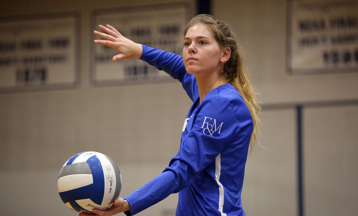 Ellie Ezekiel, volleyball team captain and a senior animal behavior major, in her recycled plastic away-game jersey.