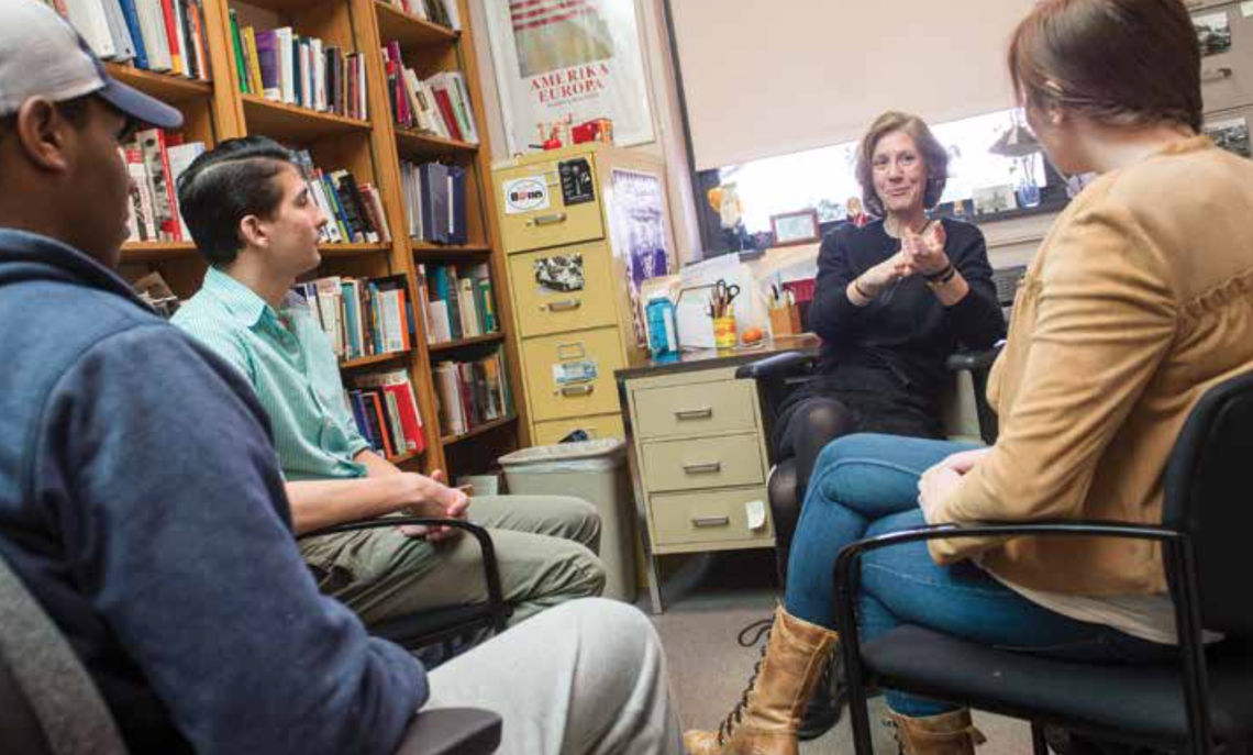 After her HIS 222 class, the discussion spills into Professor Mitchell's nearby office.