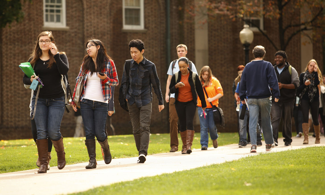 Franklin & Marshall College students bustle to class in this October 2014 photo. As of Jan. 19, the F&M Office of Admission has received 7,025 applications from students seeking places in the next first-year class, an increase of 25 percent over the previous record of 5,632, set in 2008.