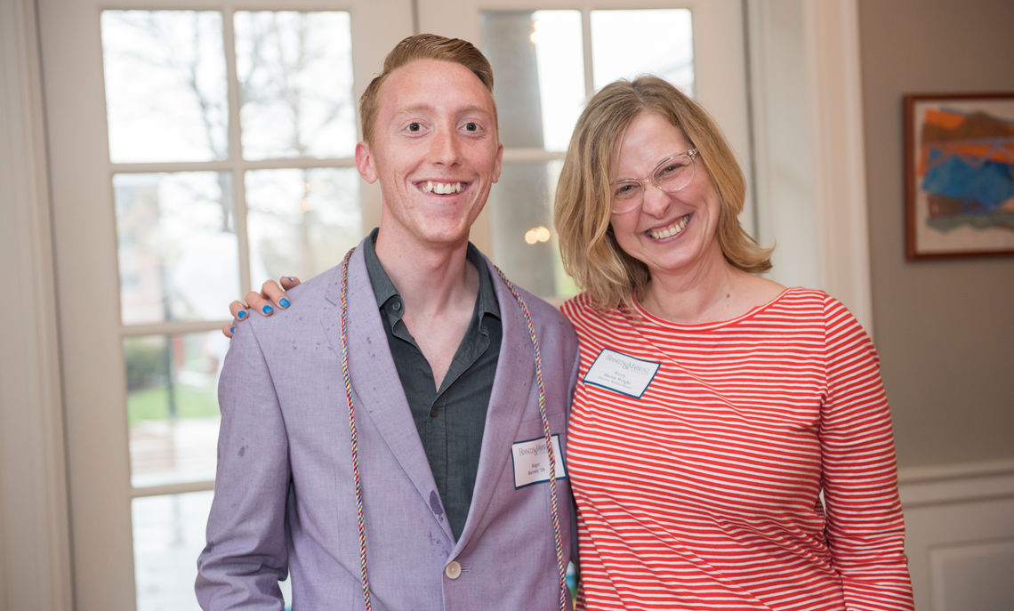 Kerry Sherin Wright, English professor and director of the Philadelphia Alumni Writers House, presented Roger Barraby '18 with his cords at Lavender Graduation.