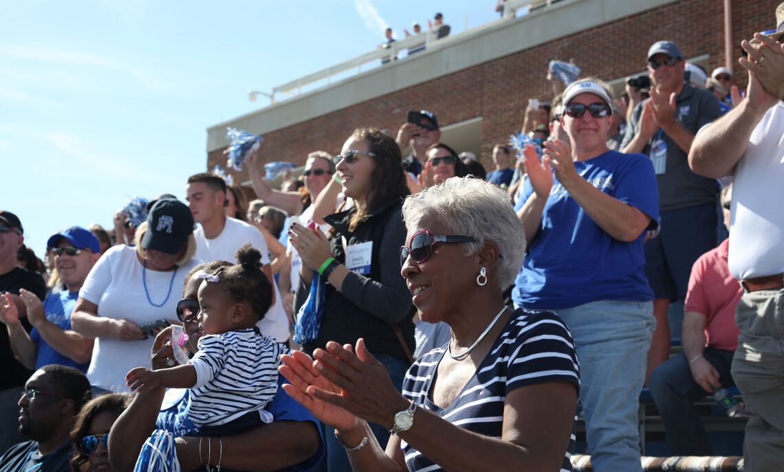 Parents celebrating during True Blue Weekend's Homecoming game