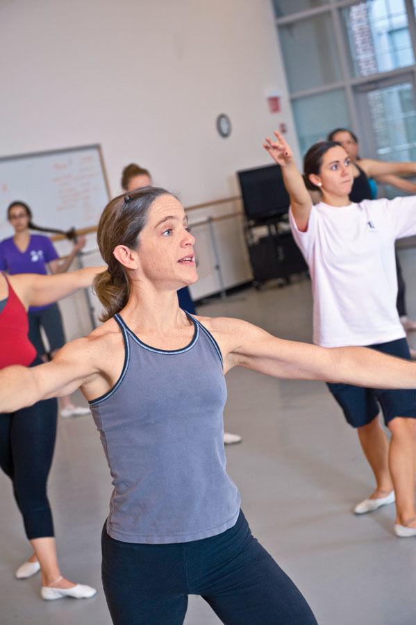 Assistant Professor of Dance Pamela Vail walks her students through a series of dance movements during an April 2012 class.