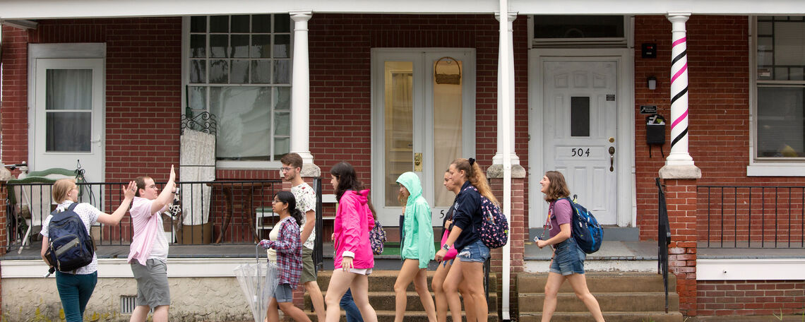 F&M students walk among Lancaster City's many row homes. The most common source for lead is in homes built before 1978, when lead-based paints were banned.