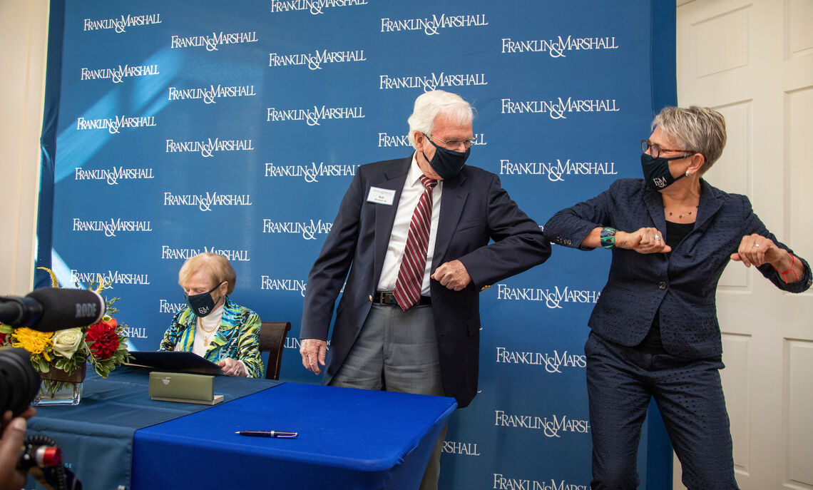 In lieu of a traditional handshake, F&M President Barbara Altmann and Dr. Robert Roschel '54 bump elbows – a new pandemic tradition – during a small ceremony at the newly renamed Roschel College House.