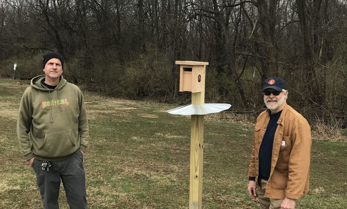 Daniel Ardia, left, and Andrew de Wet, F&M professors of biology and geosciences, respectively, have installed a series of bird boxes on the fields of Baker Campus.