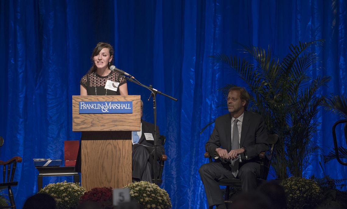 KelseyLeigh Reber '16, who has published two novels since arriving at F&M, addresses loyal donors and College supporters at Saturday evening's Tribute Dinner in the Alumni Sports & Fitness Center.