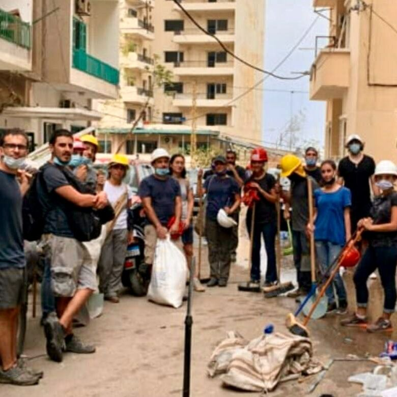 Gyokchyan (top right), teammates, and residents of Beirut gather to participate in relief efforts following the Aug. 4 explosion reportedly caused by improperly stored ammonium nitrate.