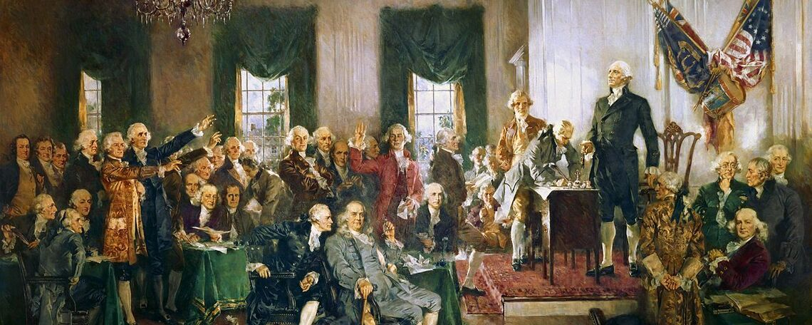 Signing of the United States Constitution with George Washington, Benjamin Franklin, and Alexander Hamilton (left to right in the foreground) in a painting by Howard Chandler Christy.