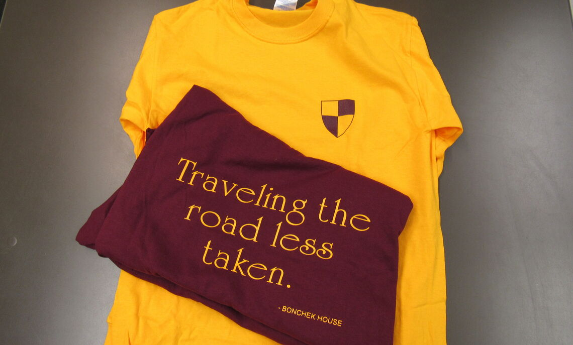 """Yellow and Red Long Sleeves. """"Traveling the road less taken"""" are on the back, with a mini bonchek logo on the front. Only 4 red available."""