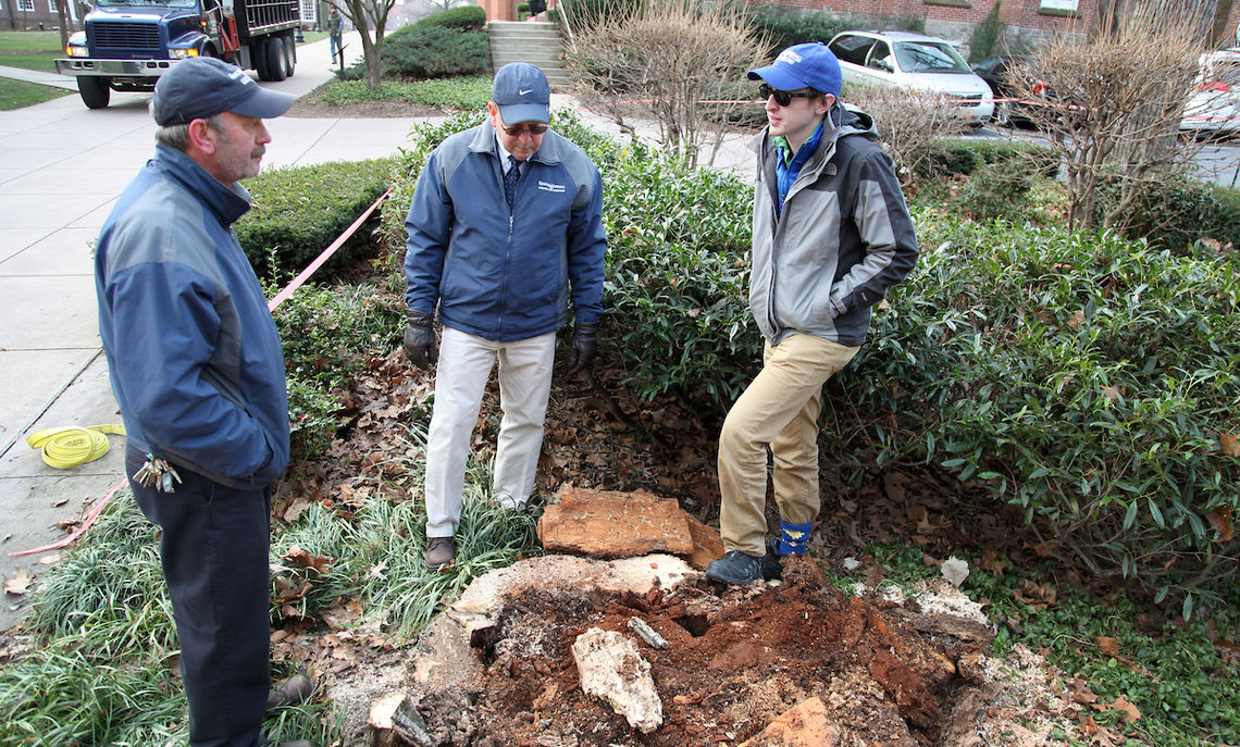 """Schmid was delicate in the removal a few years ago of F&M's iconic old Protest Tree, which had died. """"The campus is a testament to the work he does and each member of his team does,"""" says Mike Wetzel, center, with sustainability coordinator Nic Auwaerter."""