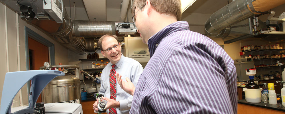 The $272,303 grant shared by Associate Professors of Chemistry Scott Brewer (right) and Ed Fenlon is their second from the National Institute of General Medical Sciences to study water's interactions with proteins and other molecules. In 2010, they received $195,895 for their research.