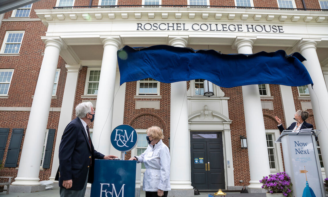 With a light touch, Robert '54 and Anna Roschel unveil the residence's new name.