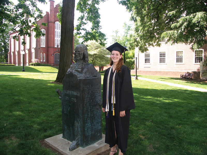 Constance Renfrow '12 poses with the Ben Franklin statue.