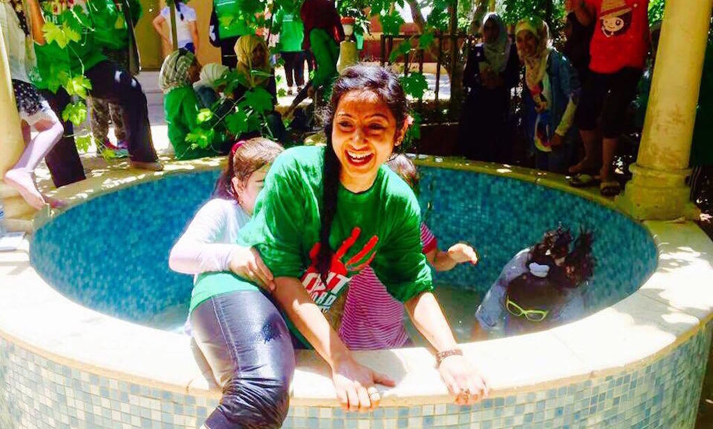 Sarah Hafiz plays in the water with some of the refugee children she and her sister, Sonia, spent time with.