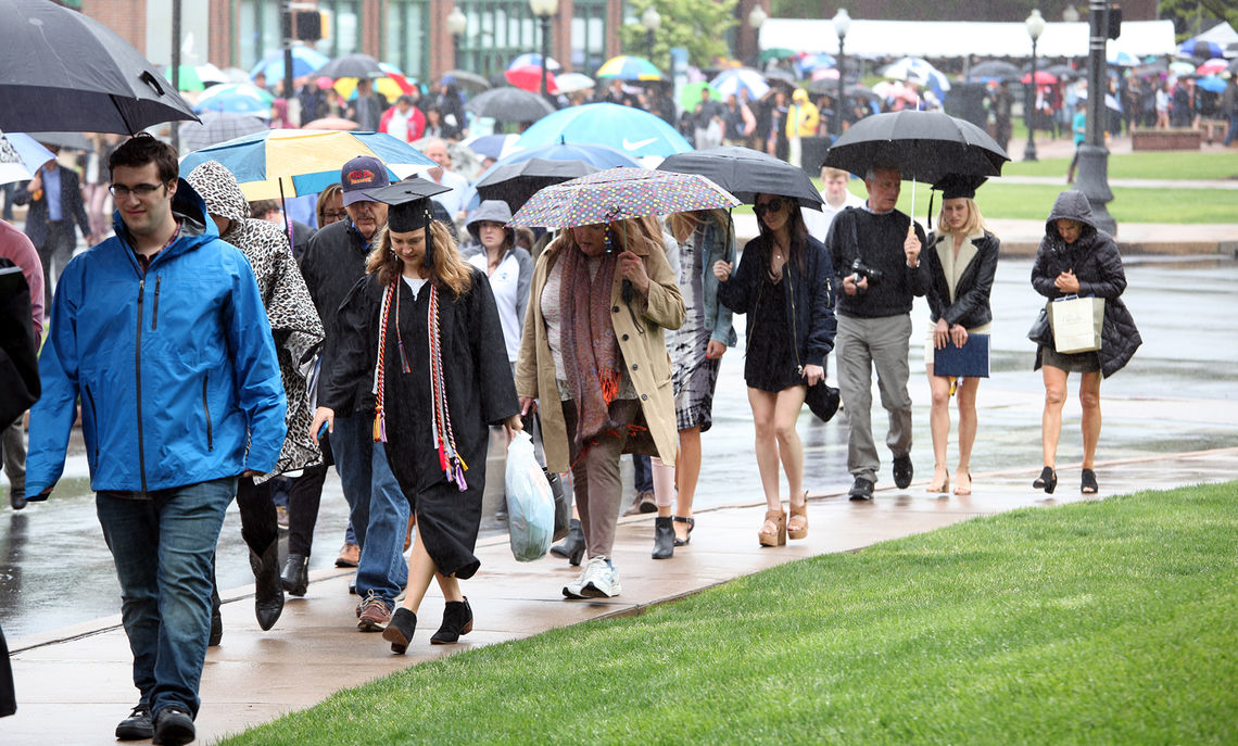 On a rainy Saturday morning, Franklin & Marshall seniors and their families and friends make their way to the Alumni Sports & Fitness Center for the College's Commencement ceremony.