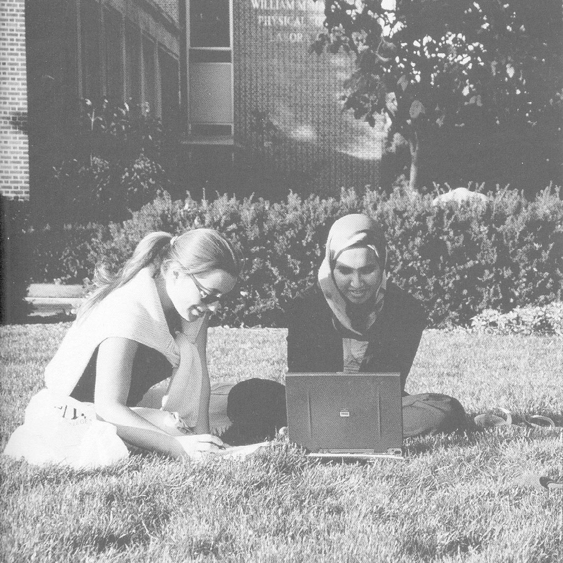Ismat Dewji (right), class of 2004, taking advantage of wireless technology, works on her laptop on Hartman Green. Serli Guleryuz, class of 2005 is at the left. 2001 photograph.
