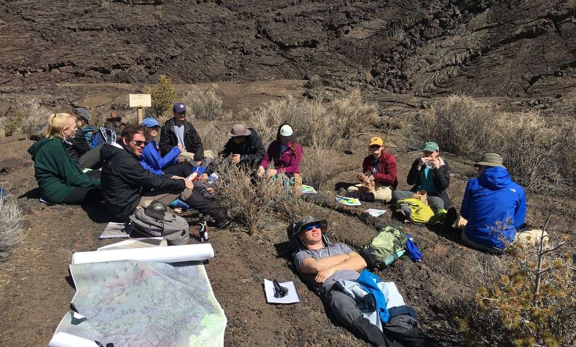 Students break for a snack on the 4,000-year-old McCarty's Lava Flow in New Mexico's El Malpais National Monument. They mapped and examined an inflated lava flow, similar to some lava flows on Mars.