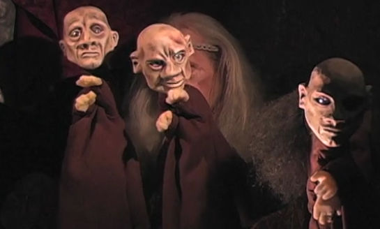 """Conrad Bishop manipulates three of the 22 puppets he and his wife, Elizabeth Fuller, use to stage The Independent Eye's production of """"King Lear."""""""