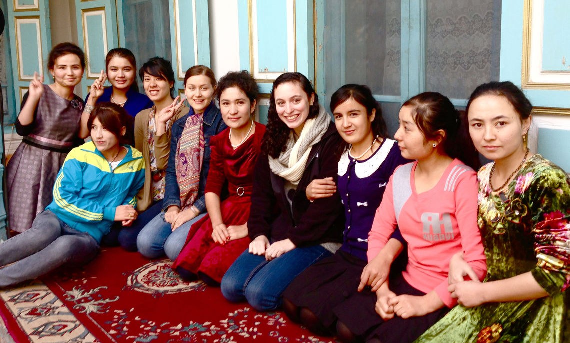In her journey across China, where she encountered a diverse range of people, senior Jaclyn Kahn (fourth from left in white scarf) and fellow classmates meet Uighur students in the Old City section of Kashgar, China's westernmost city.