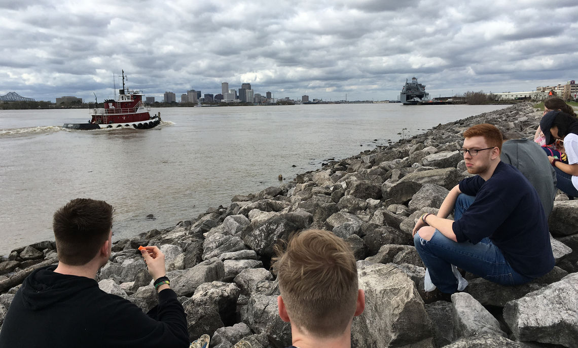Roofing crew takes a scenic lunch break along the Mississippi River.