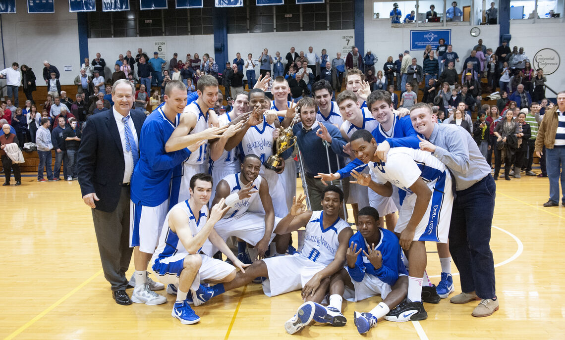 Gyokchyan and teammates celebrate the Diplomats' 2012 Centennial Conference title with former F&M Coach Glenn Robinson, the all-time wins leader in Division III men's basketball history.