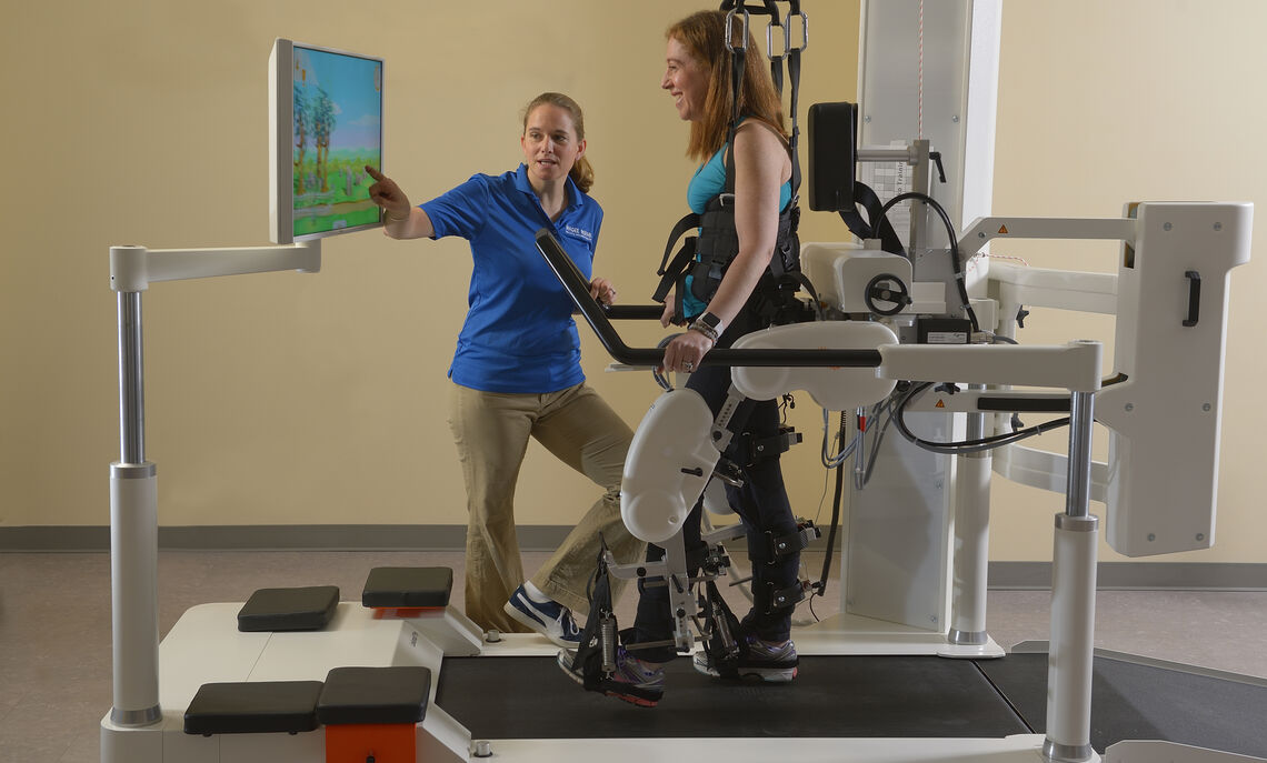 Liz Watson '98 and physical therapy patient