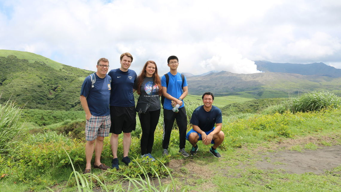 Professor Crawford and students visit the island of Kyushu's Mount Aso. This volcano erupted while they were there;  smoke pours from the crater.