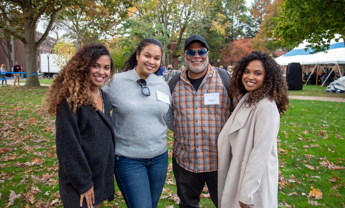 Students with family and friends gathered for the True Blue Tailgate on Hartman Green.