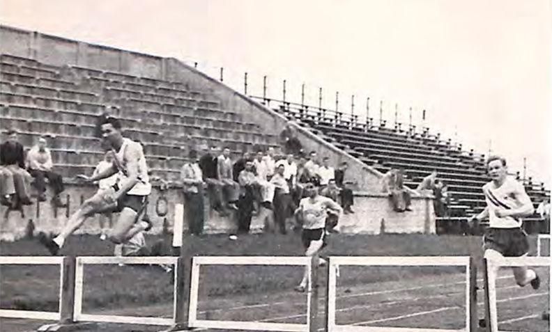 Sumner Bohee takes the 220 low hurdles against John Hopkins circa 1948.