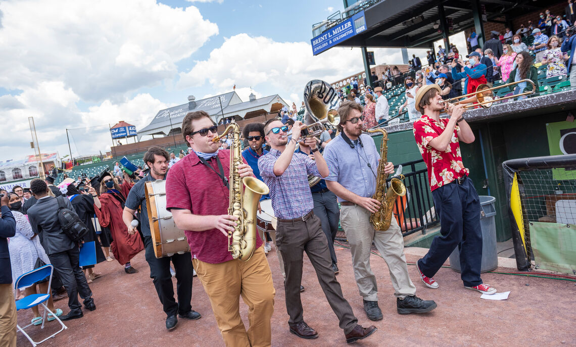 In a festive ceremony finale, Big Boy Brass music ensemble plays at F&M 2021 Commencement held May 15 at Clipper Stadium.