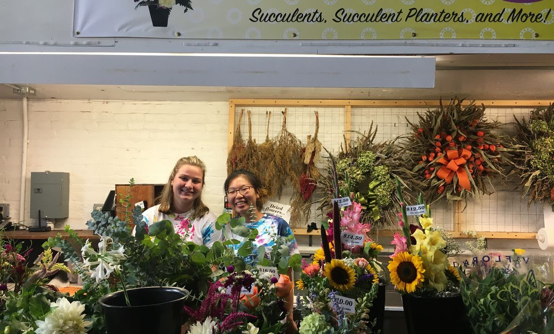 GROW 2018 volunteering at a Central Market stand.