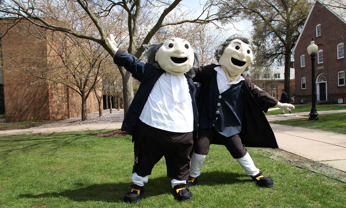 Mascots Ben and John welcome the new generation of Diplomats.