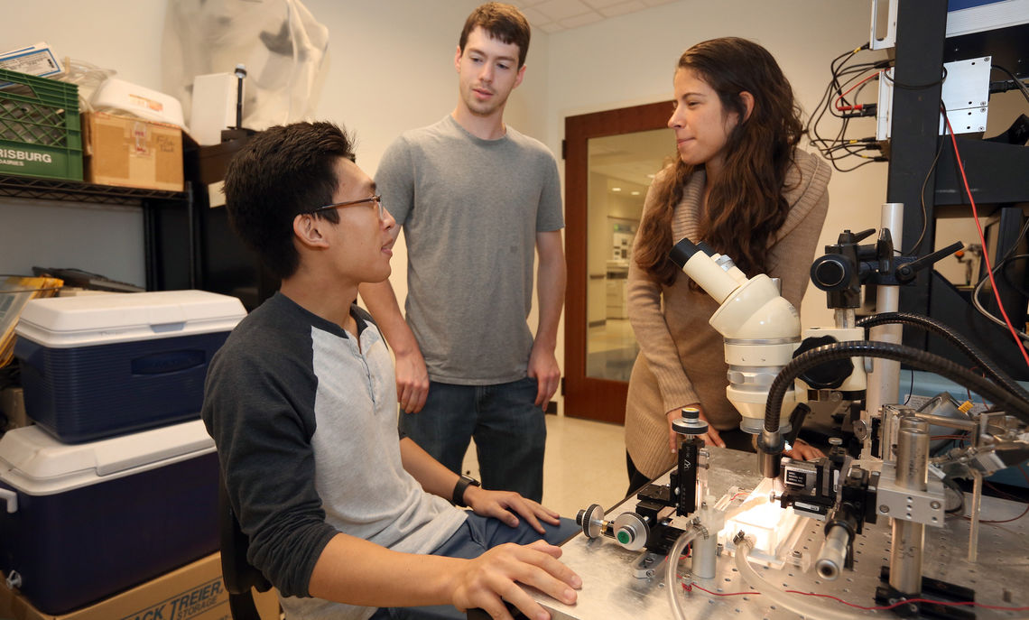 Back in F&M's lab is Largoza, seated, Diaz and senior Rich Lucanie, a biology major whose research with cuttlefish in the summer of 2015 sparked a deeper interest in the study.