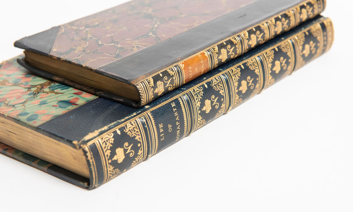 Even after Napoleon's final abdication in 1815, Empire-style bindings such as this one in the College's collection of rare books continued to be produced throughout Europe and North America.